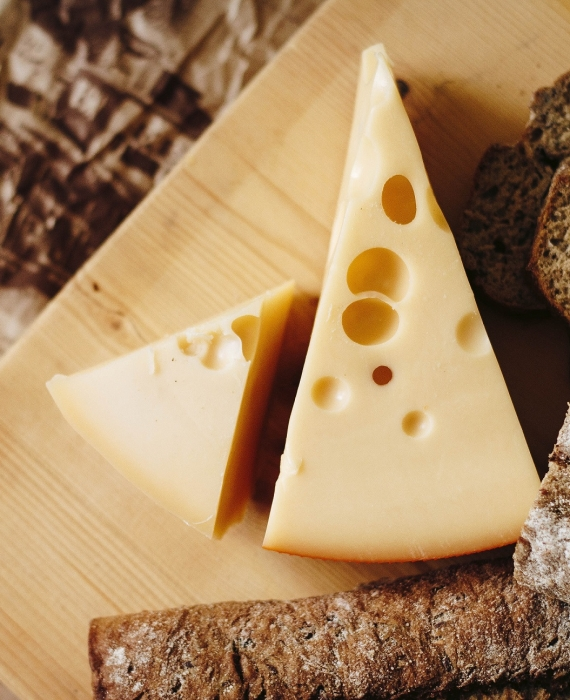 How does cheese get holes?
