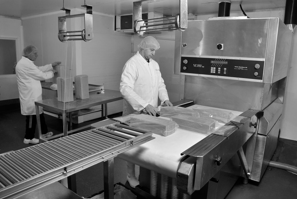 manufacturing cheese on a large scale
